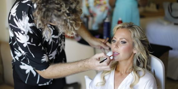 Jana gets final touches on her make up and hair for her destination wedding ,RIU Palace Playacar,Playa del CArmen,Mexico