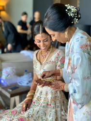 indian bride and mom getting final details