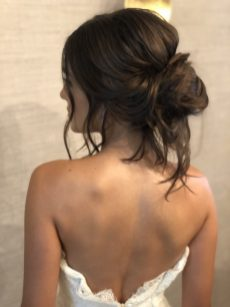 loose updo for model on a bridal photoshoot