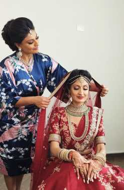 Pooja and Sister play with the dupatta after hair and makeup is done for indian wedding ceremony,riviera maya,mexico