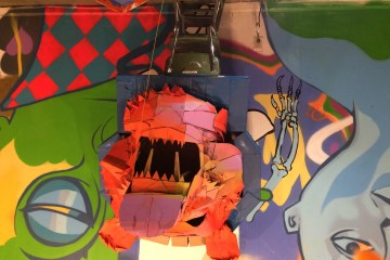 cardboard bear head on graffiti wall background