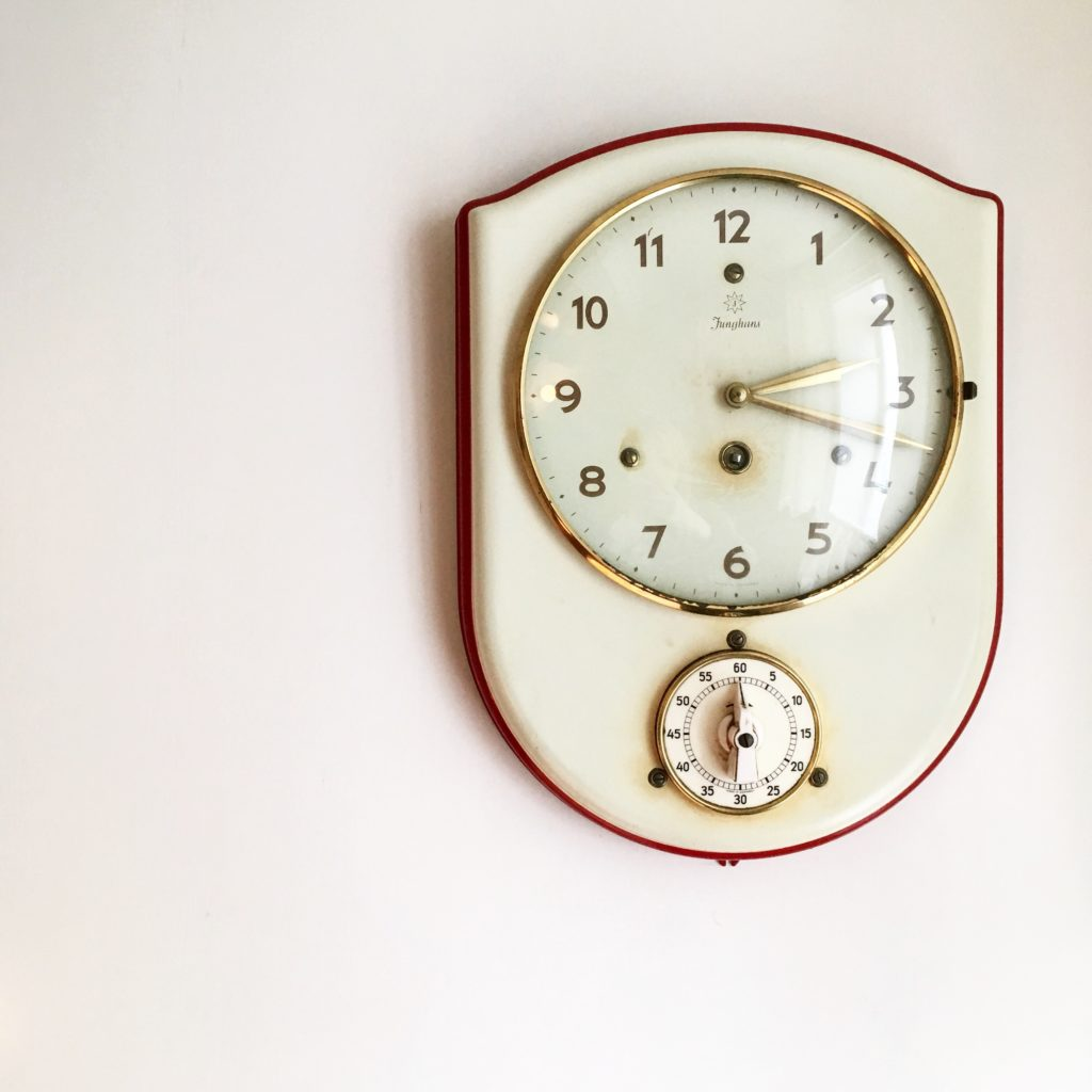 a retro clock at the Workers Cottage