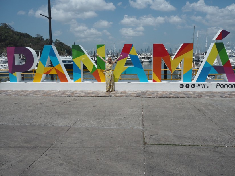 Standing in front of the Panama sign