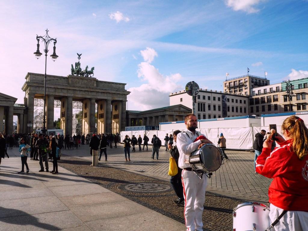 Taking photos in front of the Brandenburg Gate