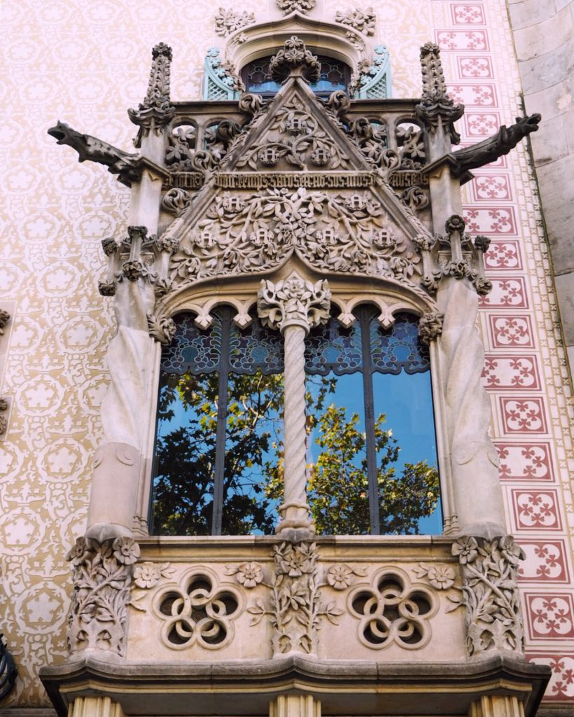 A stunning window in Barcelona with autumn leaves