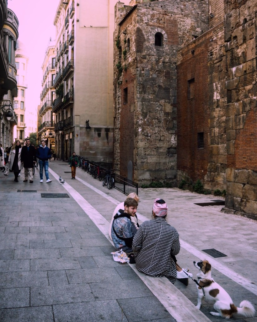 A group of young people in Barcelona's Gothic Quarter