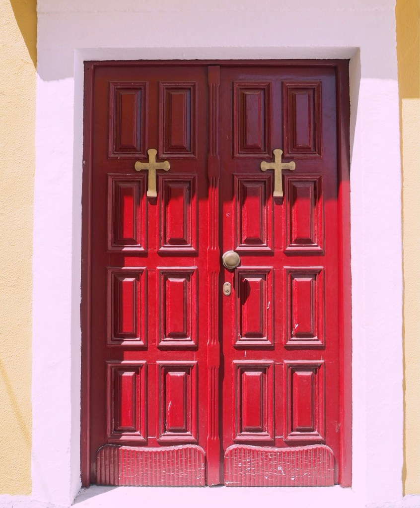 red door to a church in greece