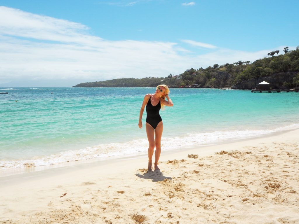 black swimsuit white sand at Place Caravelle