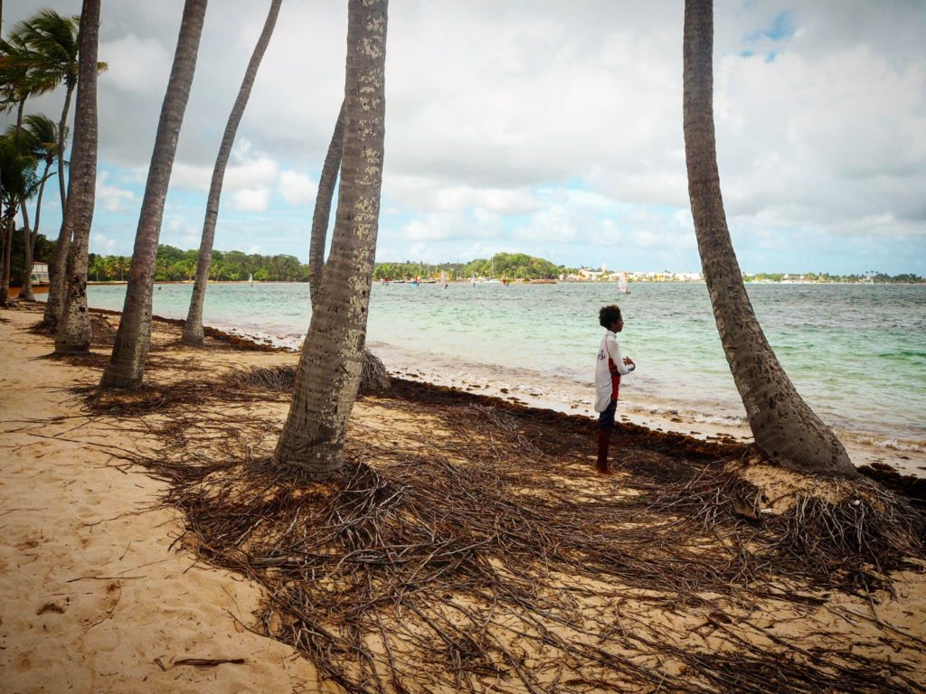 a boy on the beach in st Anne Guadeloupe