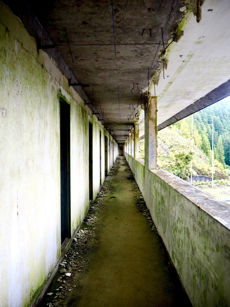 looking down a hallway at the abandoned hotel in The Azores