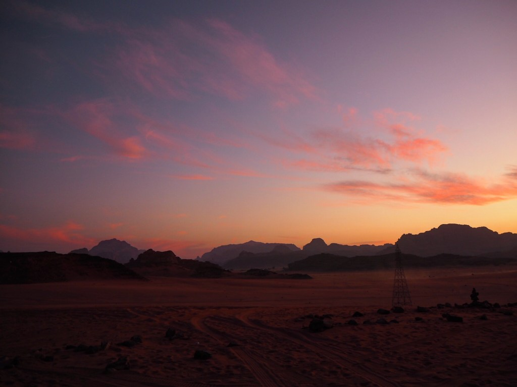 a pink and blue sunset in Wadi Rum