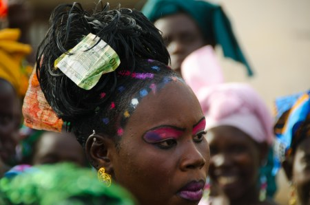 Kaddy on her wedding day to Abdou. At Wolof weddings money is traditionally put in the hair of the bride to welcome her into her new home.