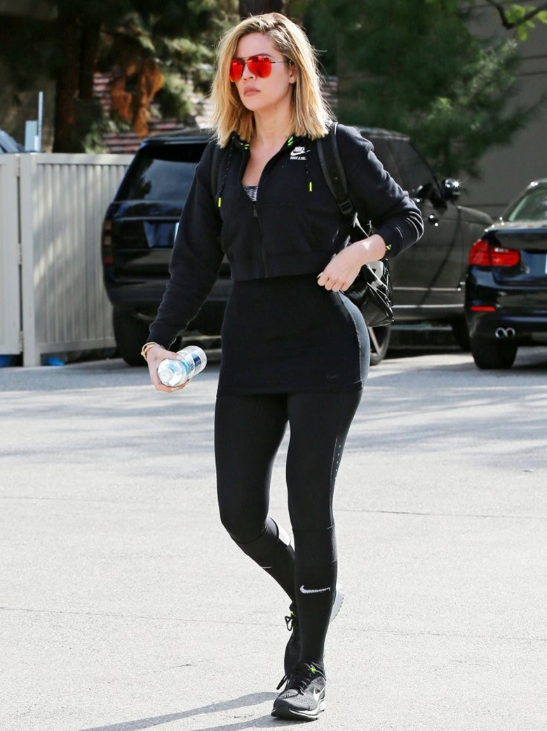 khloe kardashian black zipped hoodie black leggings red aviators