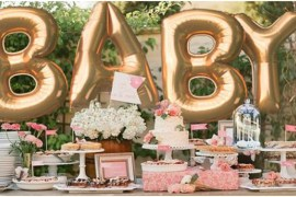 Baby Shower decorations with balloons and cakes