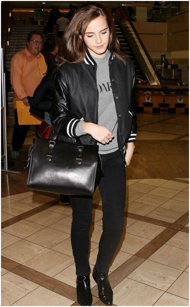 Emma Watson in black bomber jacket with black jeans and grey jumper