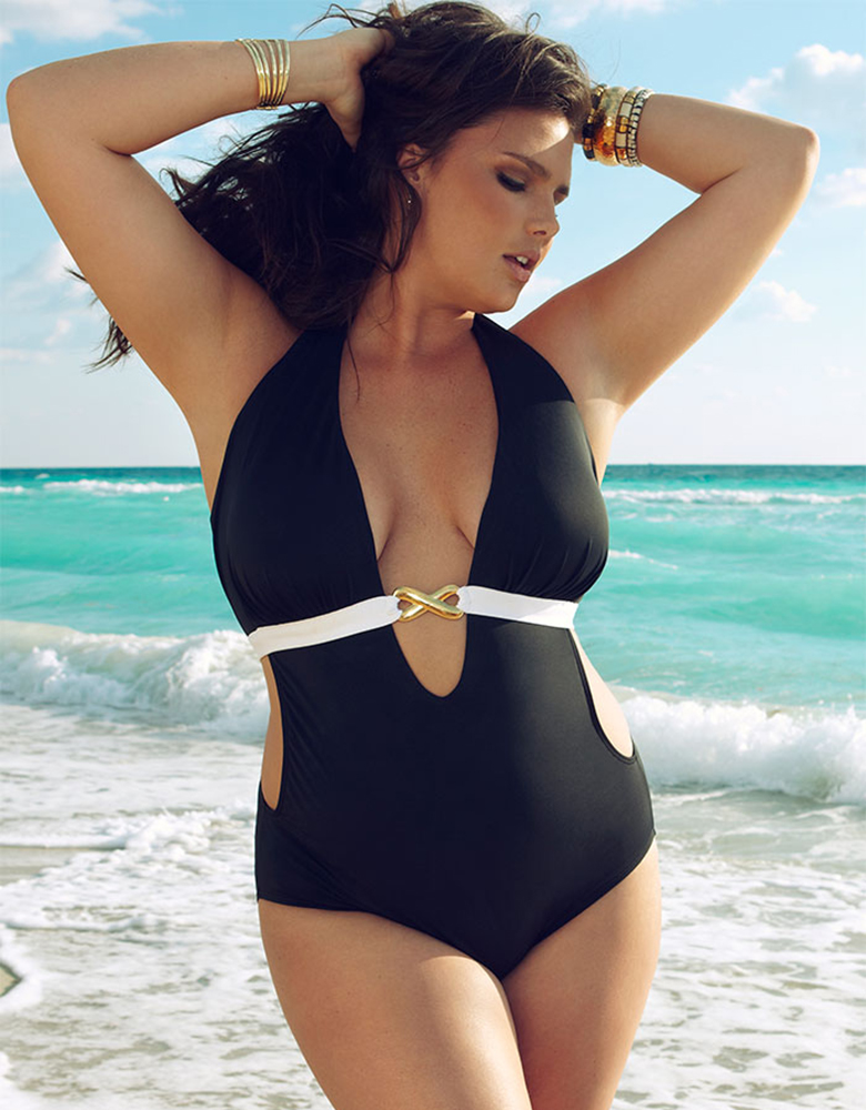 Woman on the beach wearing athletic swimwear for big busts