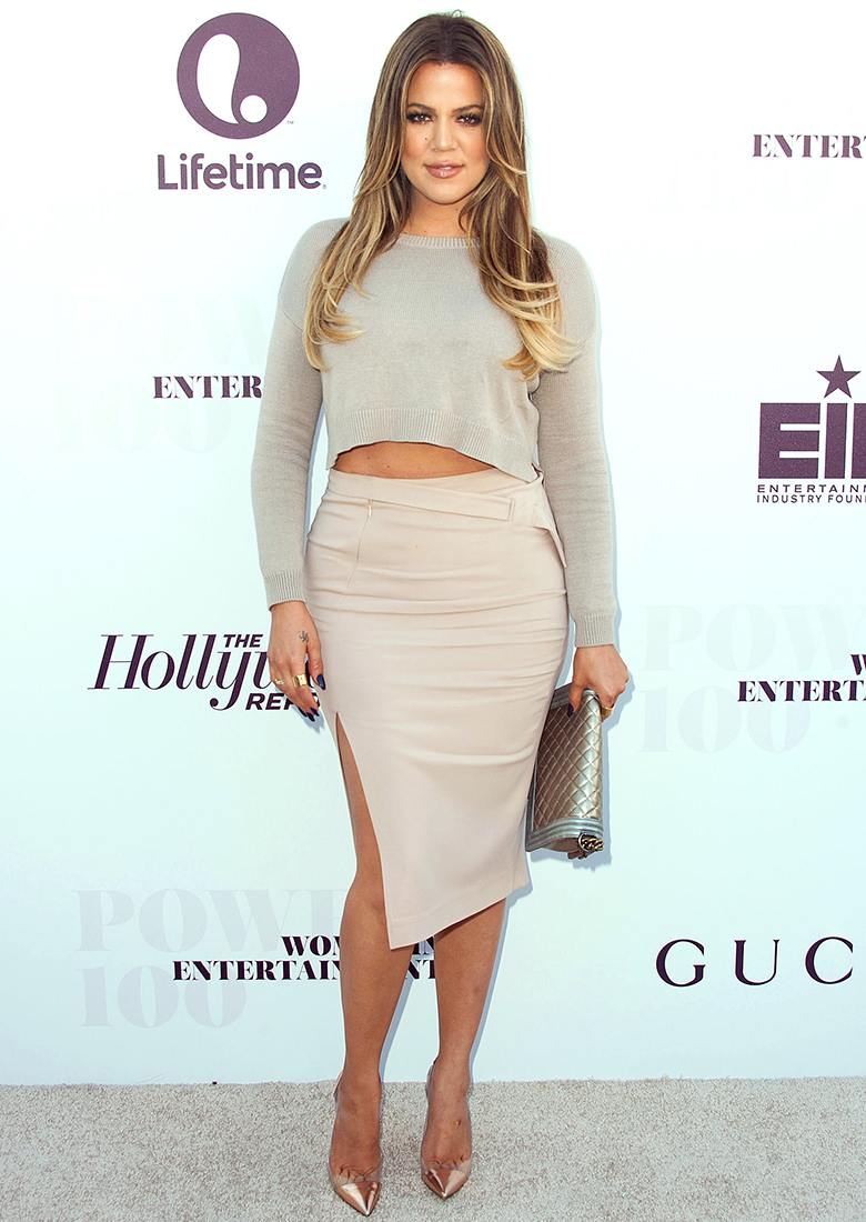 khloe kardashian wearing grey crop top, nude pencil skirt and metallic heels