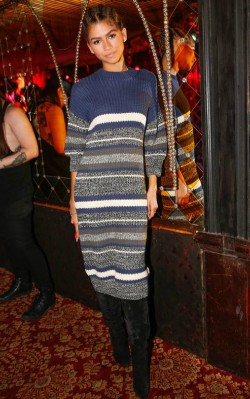 Zendaya striped sweater dress and black over the knee boots