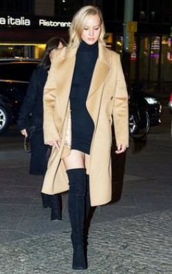Jennifer Lawrence with brown trench coat, black polar neck dress and black over the knee boots