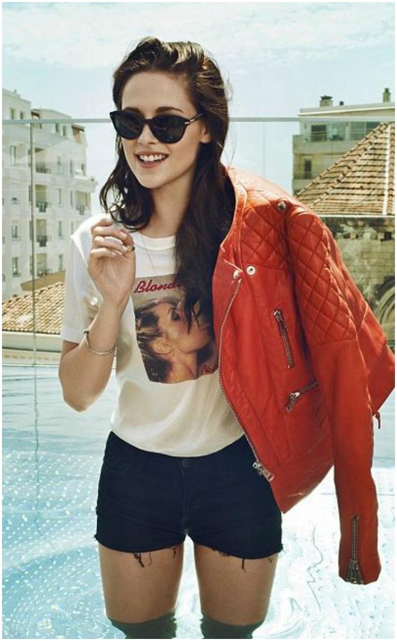 Kristen Stewart orange quilted leather jacket white t-shirt black shorts