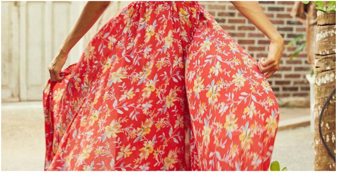Woman wearing red floral maxi skirt