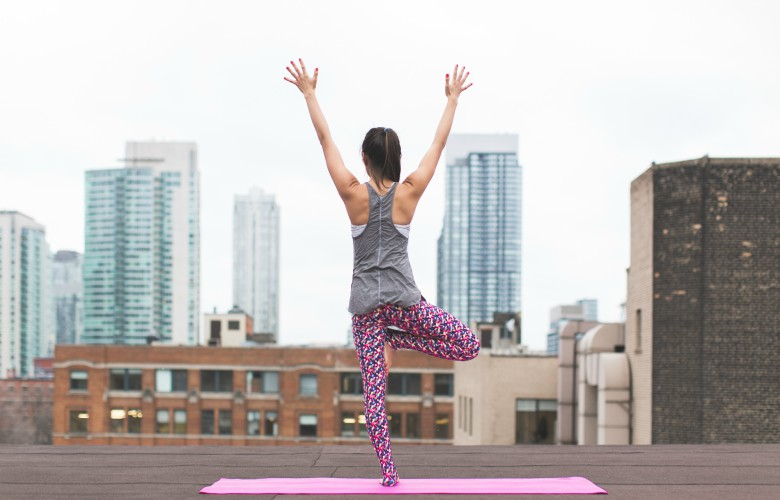Top 5 ways to increase your metabolism - exercise - workout mat and city view