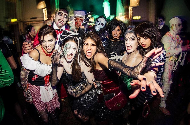 adults enjoying a halloween party