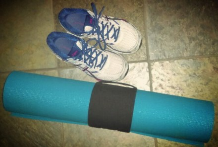 Exercise equipment - sneakers and a yoga mat