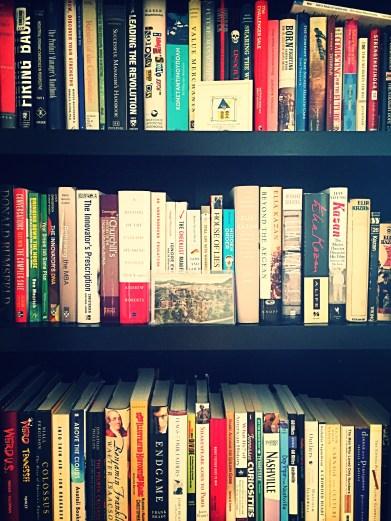 Three shelves of books