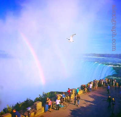 Double rainbow and seagulls over Niagara Falls, with onlookers
