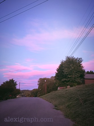 Pink and blue sunset over a suburban street
