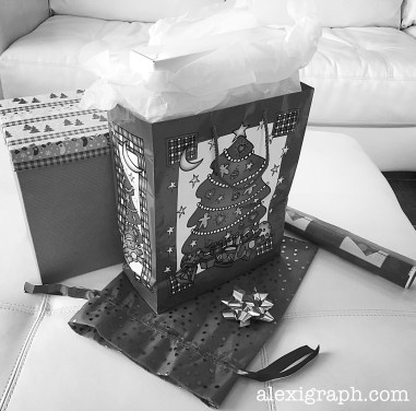 Gift wrapping items: wrapping paper, gift bags, boxes, and bow