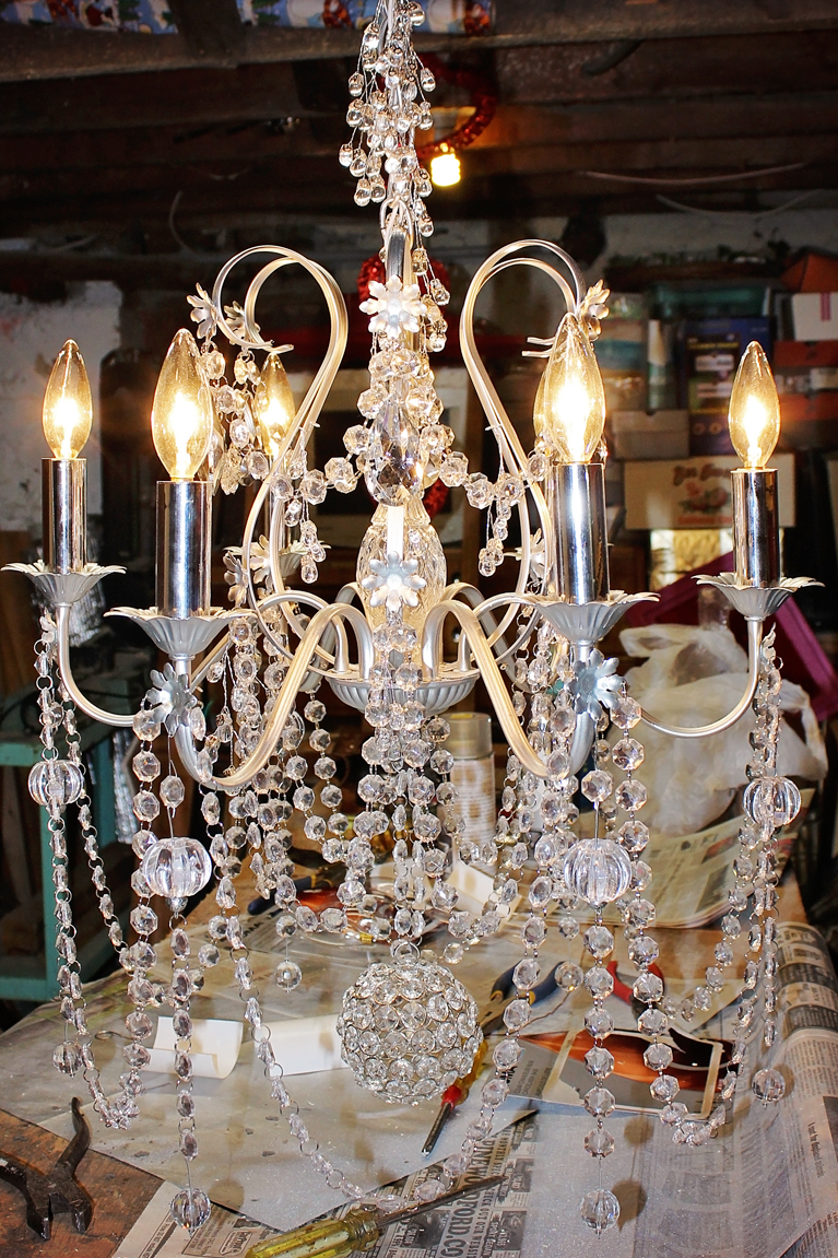 Refurbished Chandelier | Alex Inspired – Old brass chandelier is given new life with spray paint, Christmas crystal, new wiring and extra bling.
