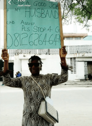 Lady who?carried placard to help her?husband get a job says the spirit of God led her to do it