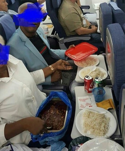 Viral photo of an African couple properly serving themselves with the food they brought aboard a plane