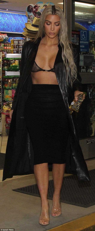 Photos: Kim Kardashian exposes her bra, flaunts boobs in new photos