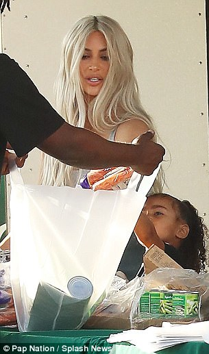 Kim Kardashian takes daughter North West to deliver food to the homeless while filming for KUWTK