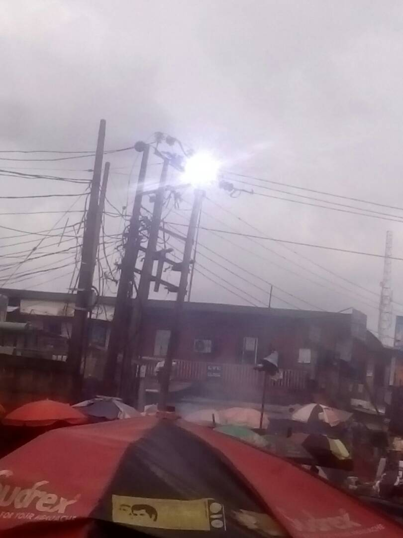 Photos: Tragedy averted as PHCN electric pole sparks at a roundabout in Lagos
