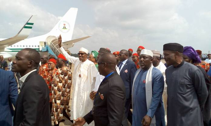 Photos: President Buhari arrives Enugu state, received by South East governors, Ministers, Royal fathers, Hausa community