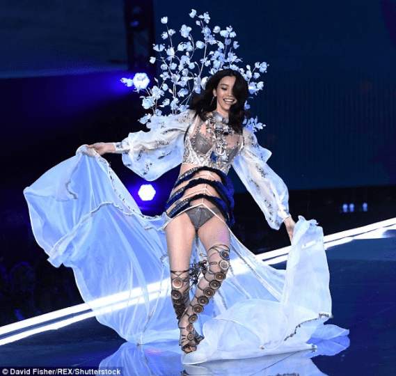 A fallen Angel! Chinese model Ming Xi falls as she gets her heel caught in her flowing ensemble at Victoria