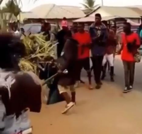 Video: Hilarious moment a masquerade fell into a gutter during a street parade!