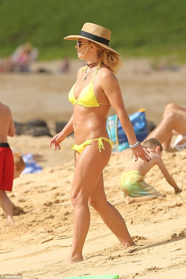 Britney Spears, 36, sparks engagement rumors with boyfriend Sam Asghari, 23, as she flashes a new diamond ring at the beach