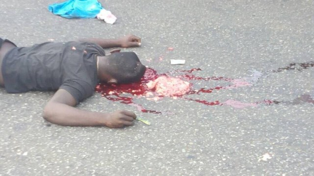 Graphic photos: Violence erupts in Benin city as police officers push bus driver to his death