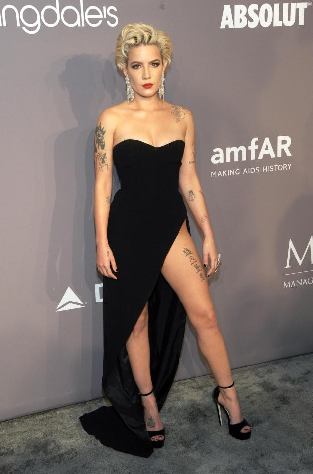 Singer Halsey suffered embarrassing wardrobe malfunction when a guest stepped on her dress and left her over-exposed on amFAR red carpet
