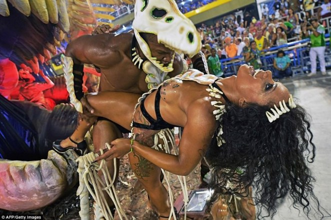 5a82e69624b11 - 20 photos of Half-naked Brazilian dancers in sparkly G-strings & skimpy wears as they flood the street for Rio carnival (Photos)