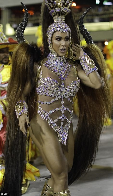 5a82e8f84c01b - 20 photos of Half-naked Brazilian dancers in sparkly G-strings & skimpy wears as they flood the street for Rio carnival (Photos)