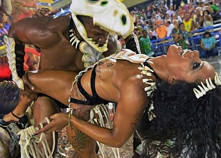 5a82eaea6c416 - 20 photos of Half-naked Brazilian dancers in sparkly G-strings & skimpy wears as they flood the street for Rio carnival (Photos)