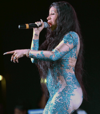 5a853d1c4902a - Bump or pregnancy? Cardi B sparks pregnancy rumors after she's seen with bulging tummy
