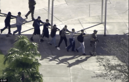 5a85641ad8294 - Harrowing video showing students screaming inside Florida school as shots were fired killing some of them