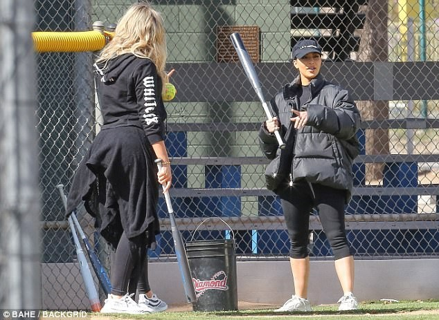 5a85655152e48 - Pregnant Khloe Kardashian cradles her growing bump while watching her sisters play softball with their mom  (Photos)